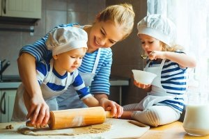 Woman with kids baking