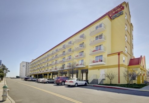 yellow oceanfront hotel exterior and street